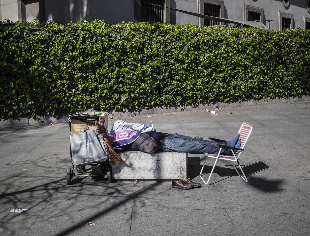 man sleeping in the street of Madrid
