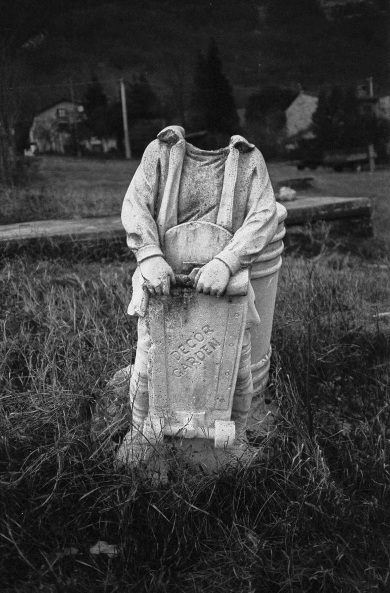 beheaded skater statue